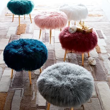 midcentury modern stools with colorful Mongolian lamb fur top