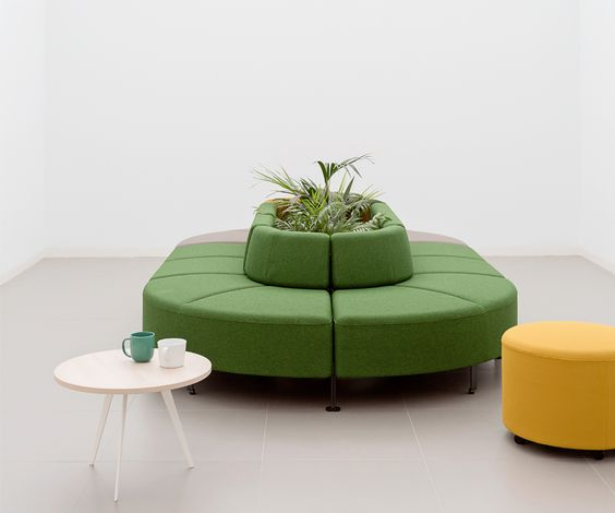 modular cushioned seat in green with center mini planter round top coffee table in white yellow ottoman