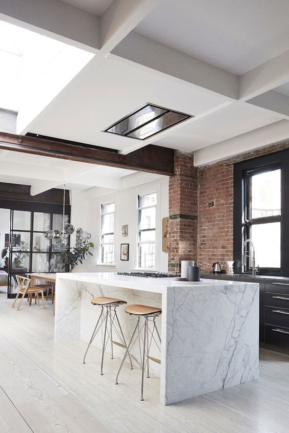 open space kitchen white marble kitchen counter red brick wall white floors white walls and ceilings