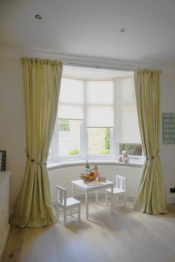 pale yellow curtains for bay window a couple of kids chairs in white kids table in white