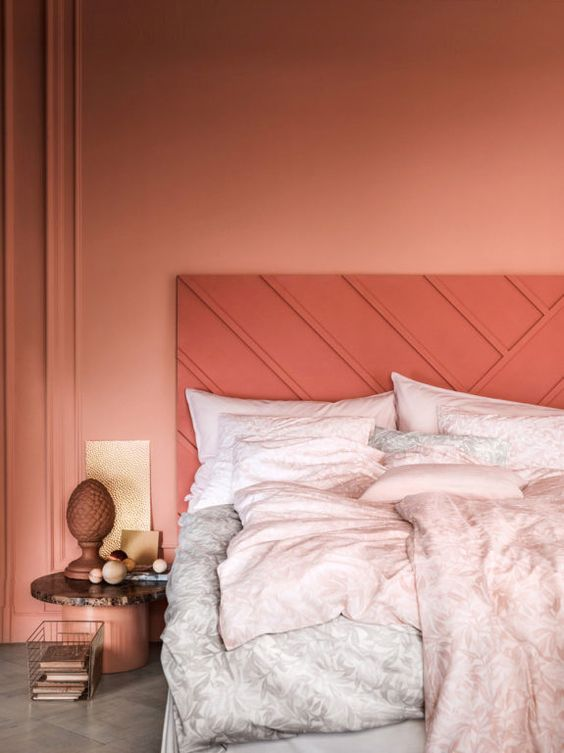 pink bedroom wall idea coral tone headboard with line accents ultra pale bed treatment