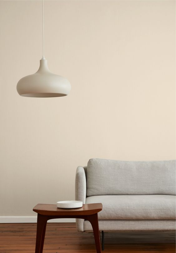 sandy beige wall idea modern white sofa dark wood side table modern white pendant
