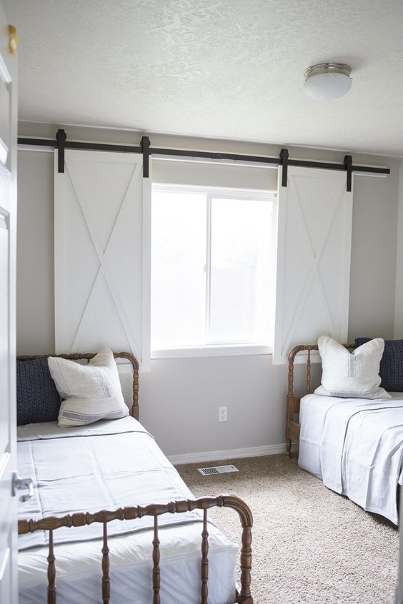 sliding barn window shutters in white traditional bed frame with headboard