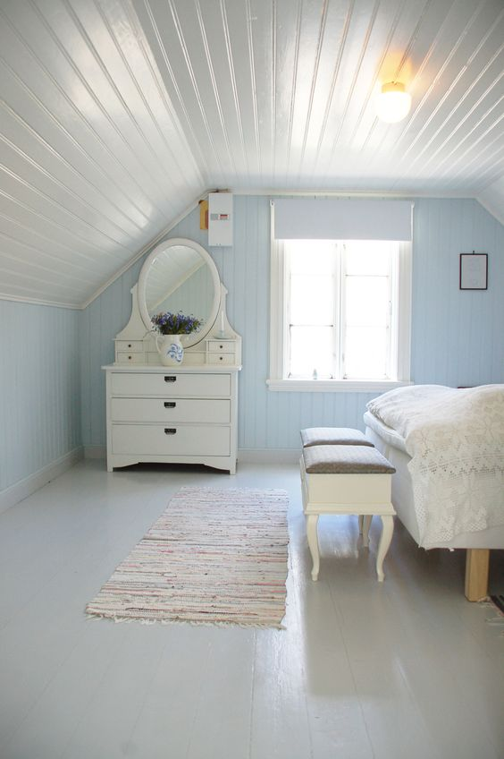 soft blue bedroom wall idea crisp white wood plank ceilings classic style makeup station classic style bench stools in white crisp white floors