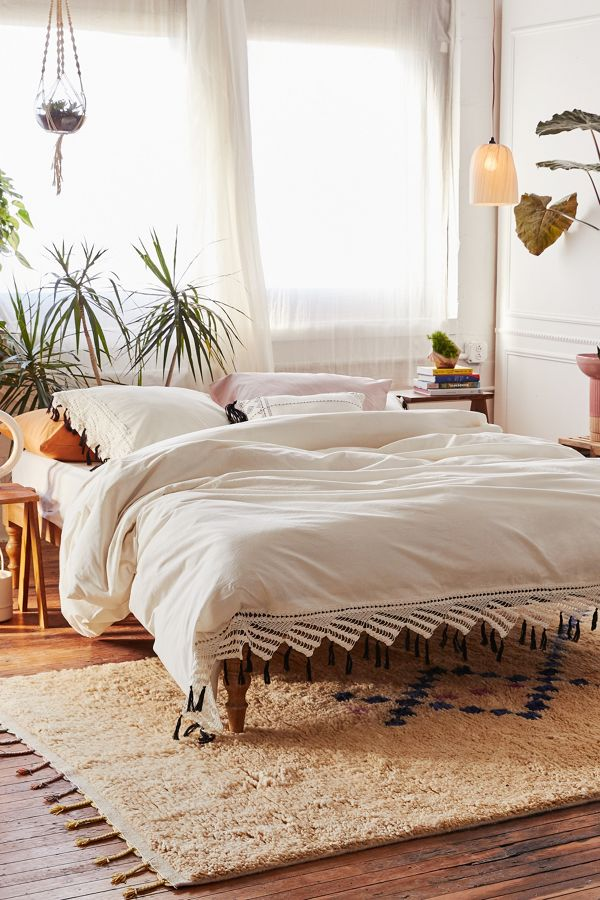 soft textured duvet cover in white with hammock like tassels