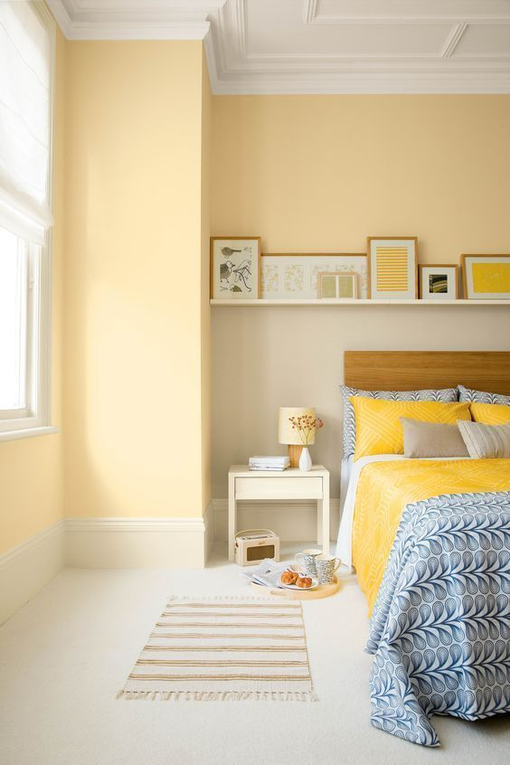 sunny bedroom wall idea white ceilings white floors striped bed mat white bedside table bed frame with wood headboard single float shelving unit for displayed frames
