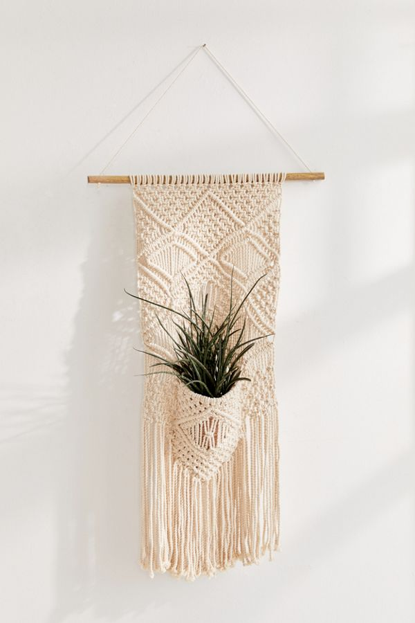 woven pocket planter wall hanging by Urban Outfitters