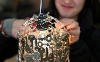 DIY pendant light made of metal wire frame covered with glued keys