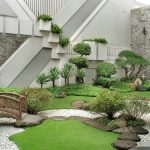 Japanese Style Backyard Idea Mini Wooden Bridge Some Grass Beds Natural Stone Walkway
