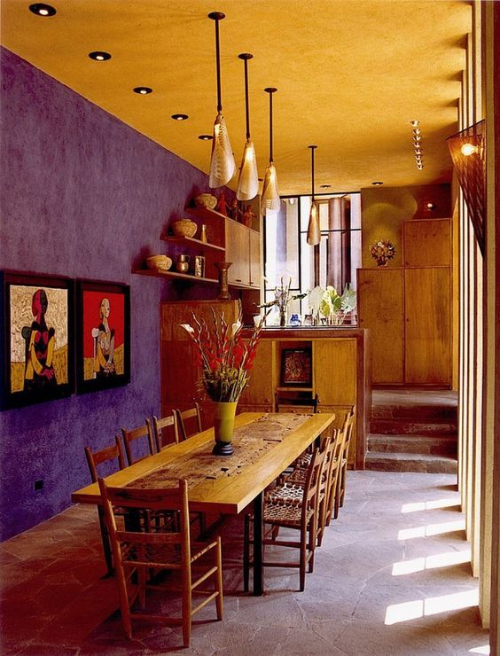 Mexican dining room purple walls gold yellow ceilings wooden dining furniture set hanging pendants