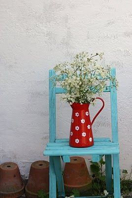 Renfrew blue chair made of wooden cranberry colored pot with white flower accents