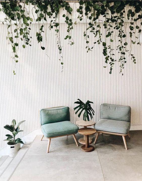 Scandinavian living room midcentury modern chair with light blue upholstery minimalist jungle decorating idea