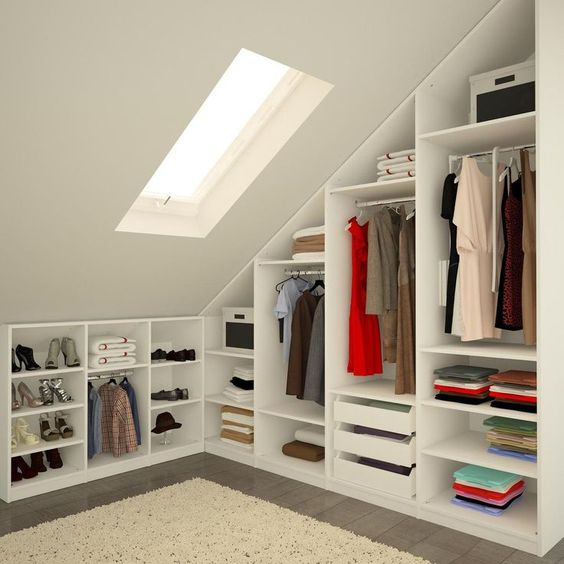 attic dressing room with custom closet and shelving unit white area rug slanted skylight