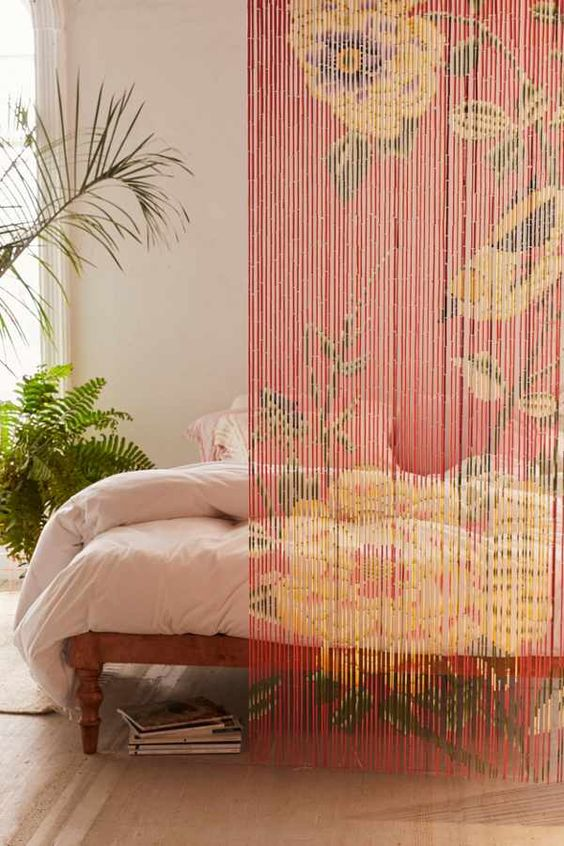 beaded curtains by Urban Outfitters with floral patterns