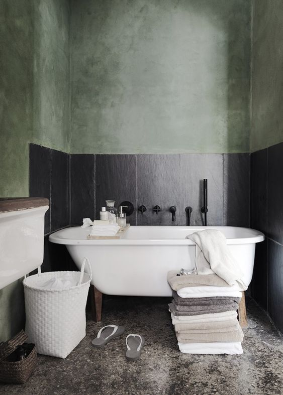 cloud featuring matte black wall idea white bathtub pile of towels concrete floors