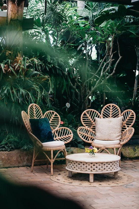 flower shaped outdoor chairs with throw pillows