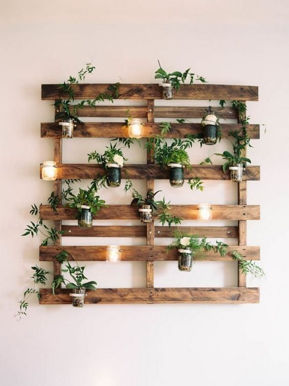 fresh greenery wall decor in rustic style