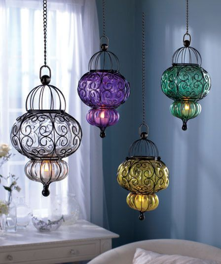 half Moroccan half Bohemian pendant lamps with bold colored glass lampshades and wrought iron holders