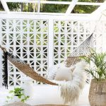 Hammock With White Shag Cushion Some Throw Pillows Floor Pillow Round Shaped Area Rug