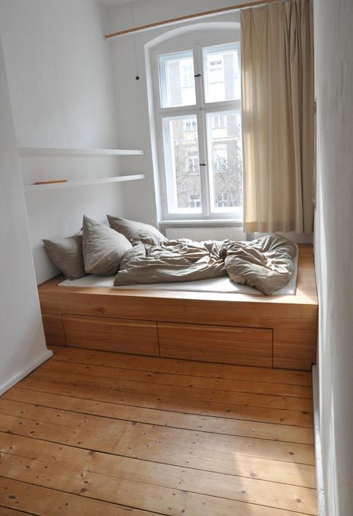 higher and heavy look platform bed made of wood with a pair of drawers