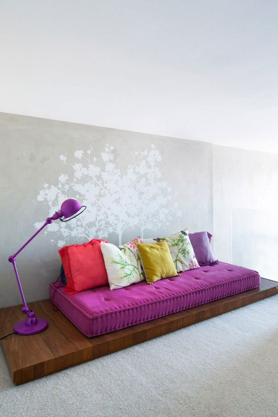 informal living room idea tufted floor cushion in purple colorful throw pillows hardwood cushion base purple floor lamp