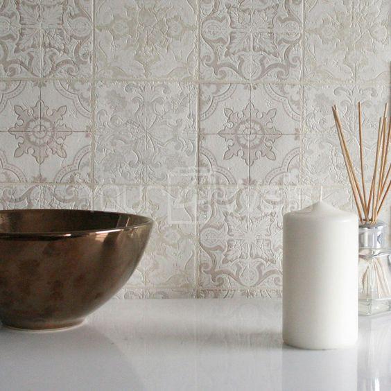 light gray Moroccan tile backsplash with embossed geometric motifs
