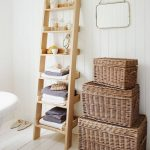 Light Wood Leaning Ladder Rack For Bathing Properties A Pile Of Woven Baskets For Storage Additions White Wood Plank Walls And Floors