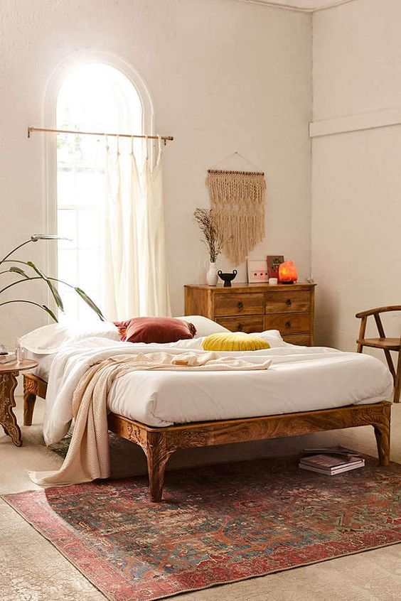 mango wood platform bed with floral vintaga pattern white bed linen idea vintage rug wood dresser white window curtains