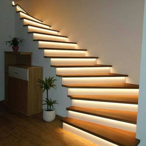 minimalist staircase with light right behind each wood step