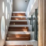 Mix Wood Concrete Staircase Idea With Ornate Lighting Effect Produced By Some Round Shaped Glass Windows