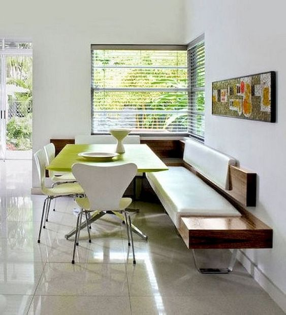 modern dining space with modern bench seat and some modern chairs