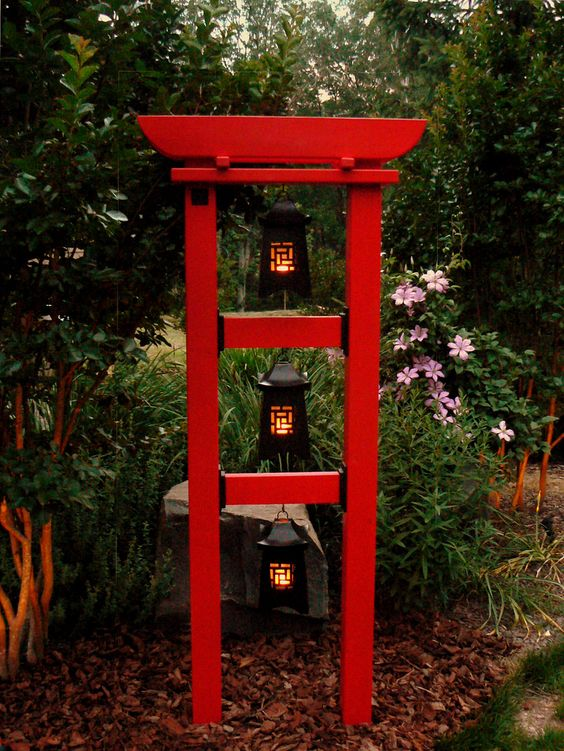 red Japanese botanical tower with three pieces of lantern