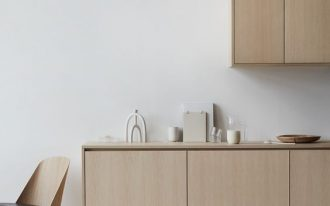 rustic minimalist kitchen design light wood kitchen cabinetry crisp white walls and floors midcentury modern dining chair
