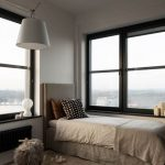 Single Size Bed Frame With Higher Headboard White Bedding Linen And Duvet Cover Black Framed & Trimmed Glass Windows Black Bench Seat Like In Bay Window