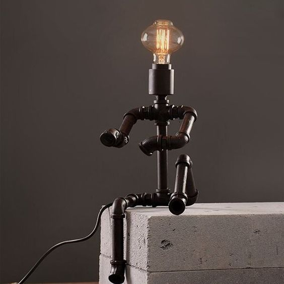 sitting man like iron pipe table lamp for industrial touch