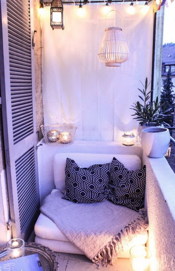 small balcony idea floor cushion with a couple of throw pillows