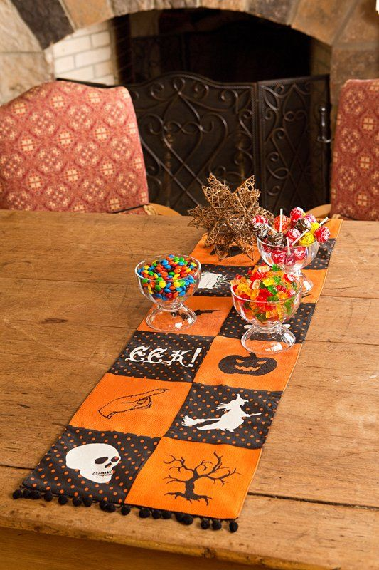smaller Halloween table runner in orange and black with Halloween prints