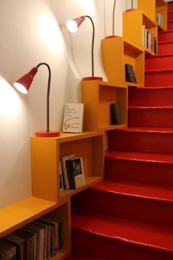 staircase update with fun and vibrant color blasts some table lamps yellow bookshelving