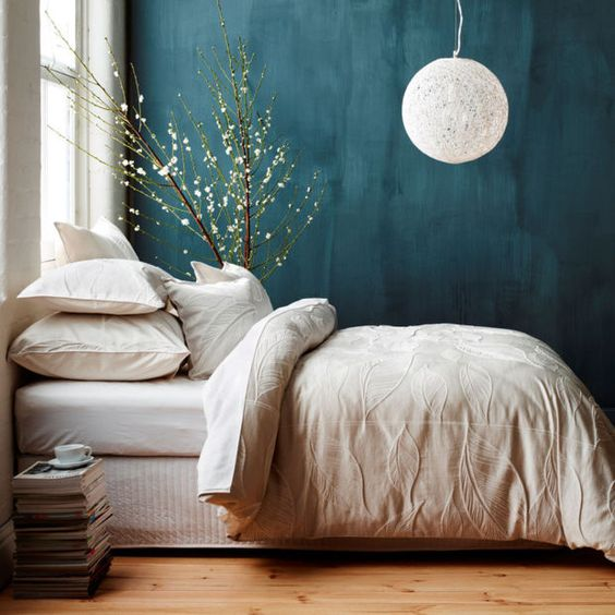 teal colored wall idea crisp white bedding treatment light wood floors oversized lantern like pendant in white