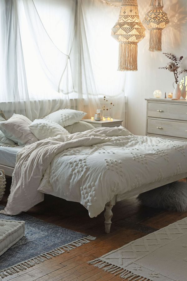 tufted bed cover with pompom details