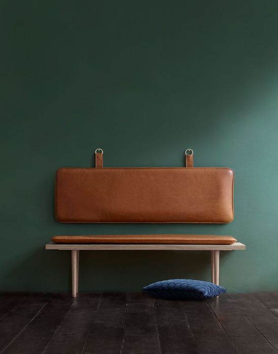 ultra modern bench with partial leather coat and wall mounted backrest