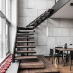 Ultra Modern Staircase In Lower Profile Large Glass Windows