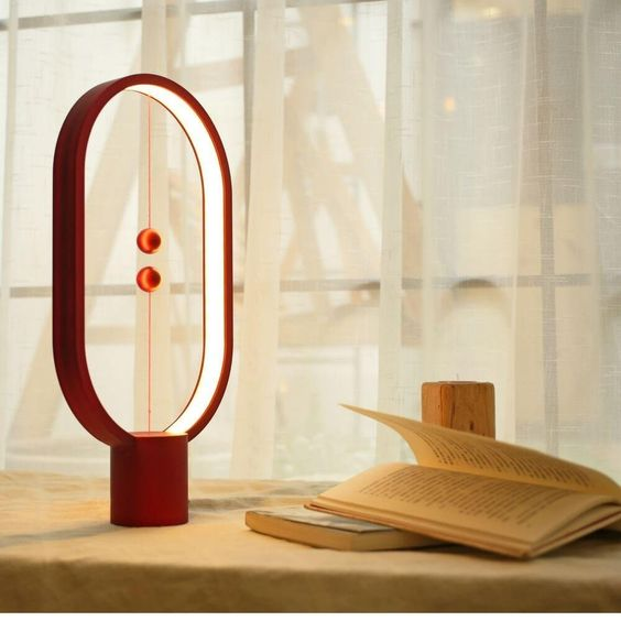 ultra modern table lamp with two magnetic balls as the switchers and balance makers