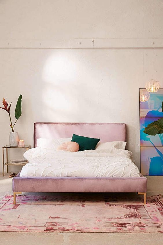velvet platform bed frame by Urban Outfitters with brass legs and straight headboard
