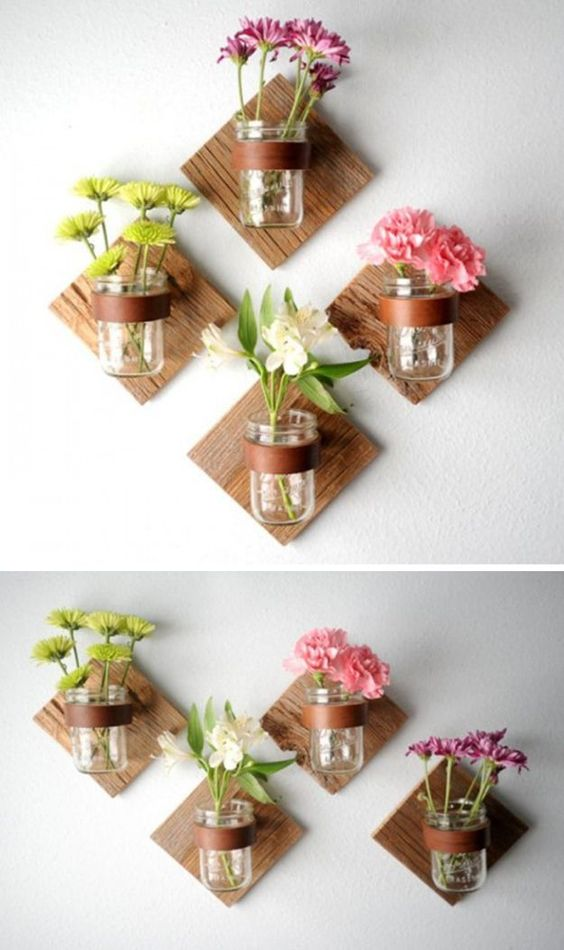 wall mounted garden with glass pot and colorful flowers