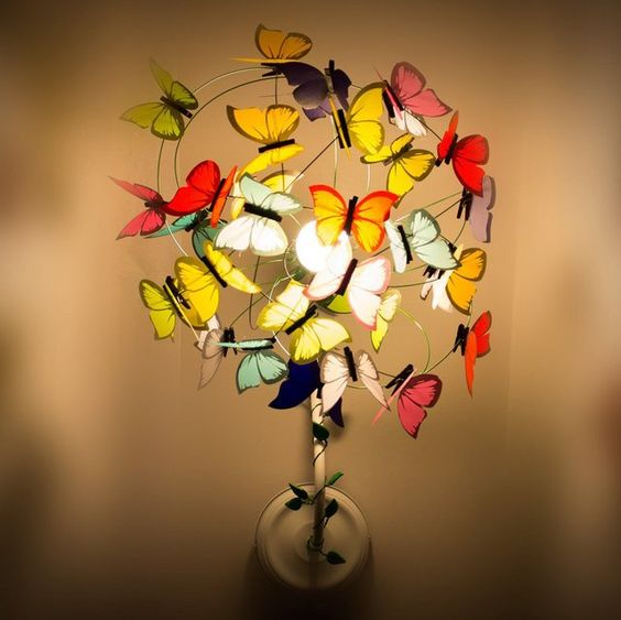 wall mounted sprout sconce surrounded by colorful butterflies