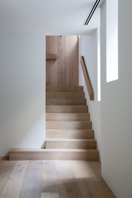 warm wood staircase in minimalist style crisp white walls light wood floors