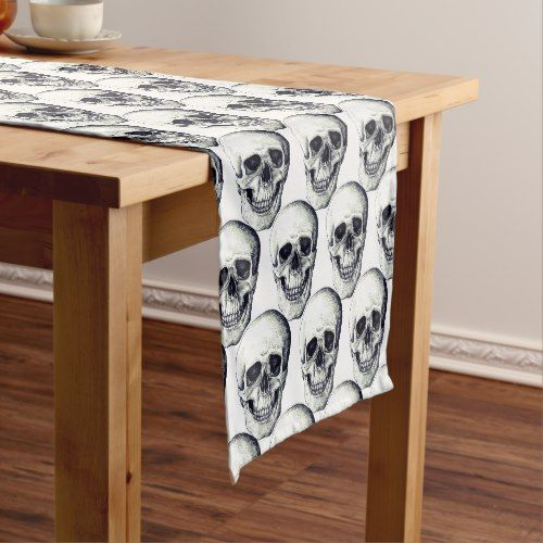 white Halloween table runner with lots of skulls