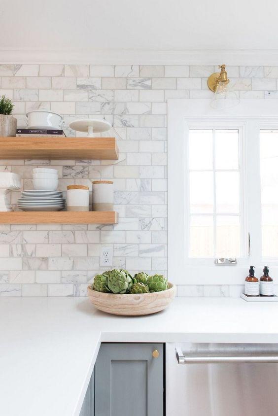 white kitchen design wooden open shelves gray kitchen cabinetry white subway tile backsplash with stains white countertop