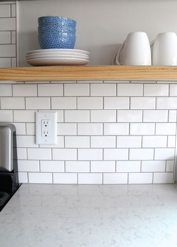 white subway backsplash with grout open shelf made of wooden white ceramic kitchen countertop